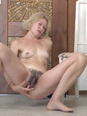 Diana Douglas enjoys masturbating in her hallway