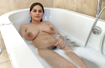 Hairy woman Riani takes a warm bubble bath