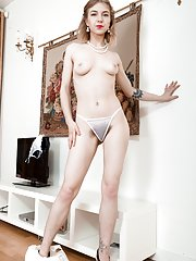 Kristinka models her new white dress and strips