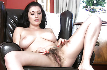 Beautiful busty brunette Brook Scott's having a sit when she gets an itch that needs scratching. She strips off her clothes and begins to rub her moist hairy pussy, on and off the chair until she cums