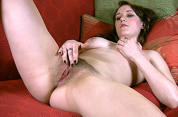 Cute natural girl next door Michelle L explains some of her deepest fantasies and gets so turned on she finger fucks her moist pink bush on the couch.