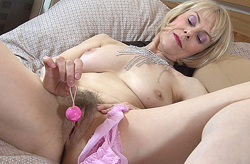 Hairy Hazel takes of her sexy lingerie and fucks her wet bush with a arrange of vibrating toys. She pushes deeper and deeper while flicking her clit to come to a shivering orgasm.