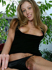Thin amateur coed shows her hairy pussy