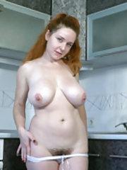 Elouisa strips naked in her kitchen to masturbate