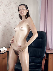 Lulu oils up her body and strips naked to enjoy