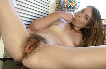 It is her day off and hairy girl Louise Harmen is getting some chores done around the house. As she gets the suds and water all over her hands, her hairy pussy becomes moist as well.