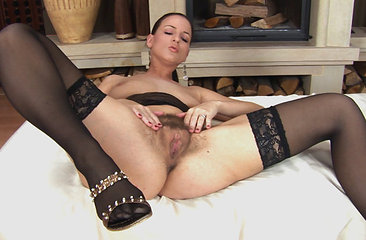 Sexy Wallerai lays down in front of the fireplace in her sexy black lingerie and finger fucks her moist hairy pussy until she is completely satisfied.